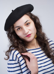 Young Beautiful Woman with French Style Beret and Striped T-Shir