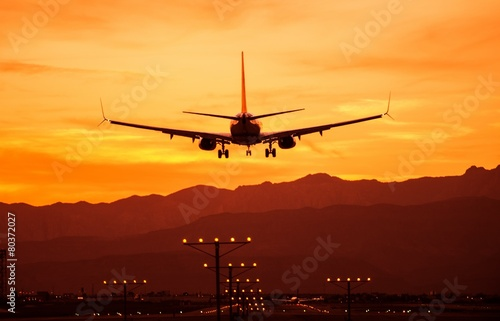Landing Airplane at Sunset - 80372027