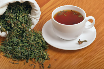 Herb and healthful tea cup