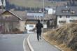 man running in mountain road