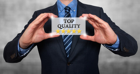 TOP Quality with five stars - Businessman with sign