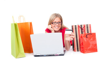 Woman searching for online shopping, holding credit card