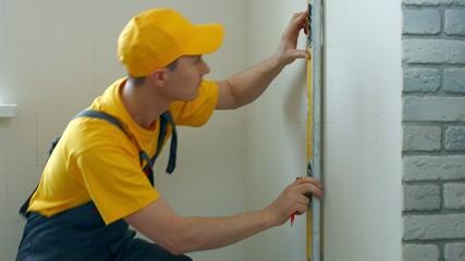 Engineer draws  scheme on the wall.
