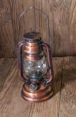 kerosene lamp on a wooden background