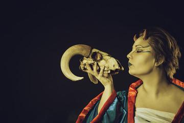Horned cute demon with skull