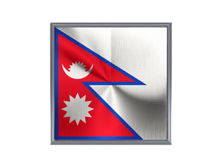 Square metal button with flag of nepal