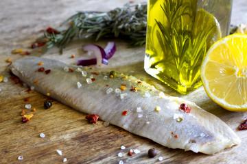 Herring fillet in oil vintage still life food background concept