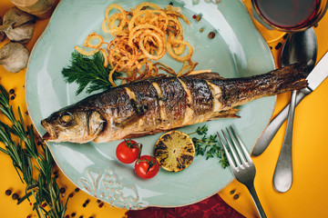 Plate of grilled fish with squid and tomatoes