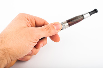 Hand with electronic cigarette agains white background