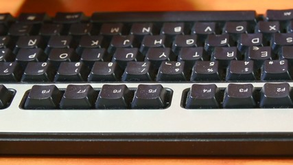 Closeup view of the use of a computer keyboard, office. 4K.