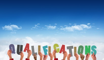 Composite image of hands holding up qualifications