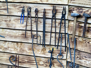 Collection of metal tools in smithery