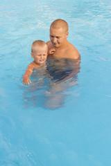 Dad teaches his son to swim