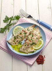 fish fillet with pink pepper and lemon sauce