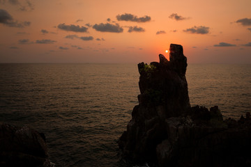Sunset over the sea with cliffs like eating dun