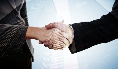 Two businesspeople shaking their hands