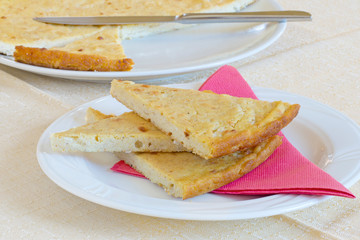 Barbotta slices on plate. Lunigiana speciality, Italy