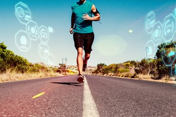 Composite image of athletic man jogging on open road