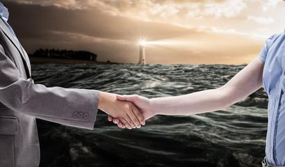 Composite image of handshake between two women