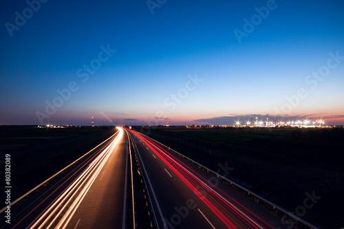 Cars speeding on a highway - 80382089