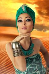 Beautiful woman in oriental style in turban