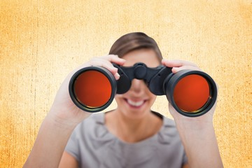 Composite image of woman looking through spyglasses