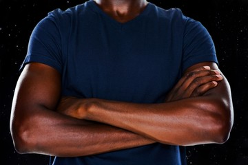 Composite image of close up mid section of man with arms crossed