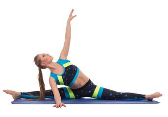 Graceful female athlete doing gymnastic splits