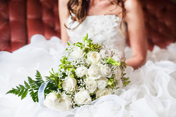 closeup bride holding bouquet of roses