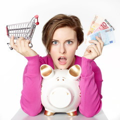 Woman  saves money with piggy bank for shopping