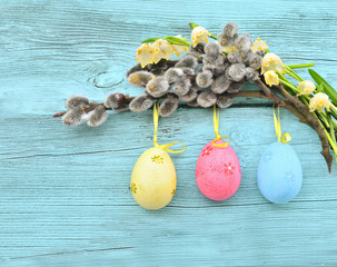 Happy Easter. Pussy-willow, snowdrop flowers and colorful eggs