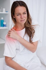 Woman covering painful spot