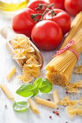 raw pasta olive oil tomatoes. italian cuisine