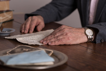Male hands holding old letter
