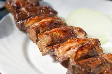Closeup photo of lamb liver skewers