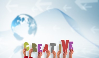 Composite image of hands showing creative