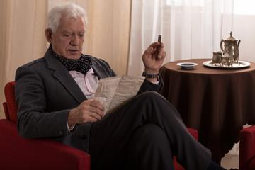 Elder man reading old letter
