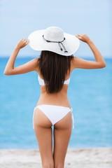 Attractive. Bronze Tan Woman Sunbathing At Tropical Beach