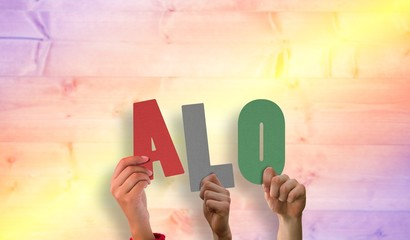Composite image of hands holding up alo
