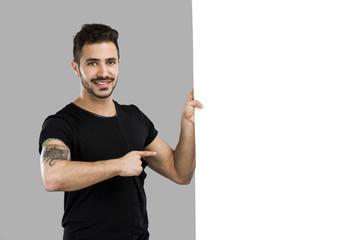 Latin man holding a blank billboard