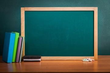 Classroom. Empty school blackboard with books and sponge