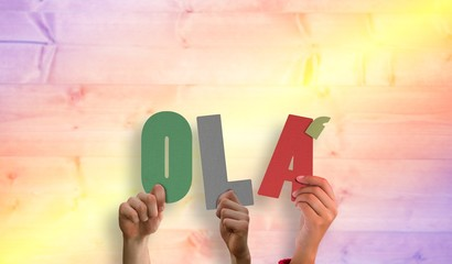 Composite image of hands holding up ola