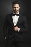 Fototapety Latin man wearing a tuxedo