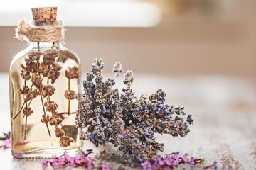 Oil. bottle of lavender oil with fresh flowers on wooden