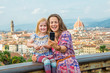 Happy mother and baby girl making selfie  in  florence
