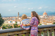 Mother and baby girl against panoramic view of florence, italy