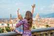 Mother and baby girl looking on panoramic view of florence