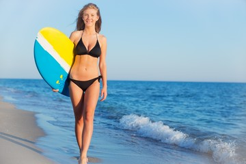 Beach. Beach woman swimming fun with body surfboard. Happy