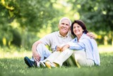 Old. happy Mature couple walks in the park in summer day