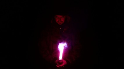 Man holding purple bengal fire